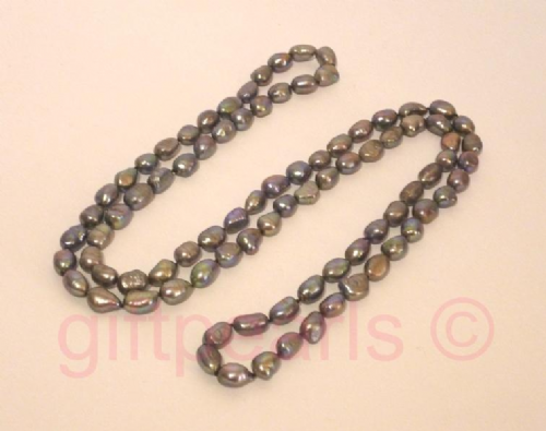 Large black baroque pearls 32 inches.